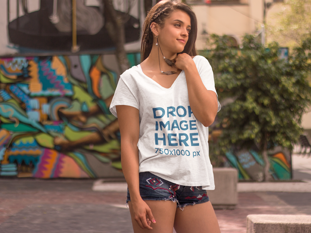 Hipster Girl Standing in Front of a Mural T-Shirt Mockup a7618