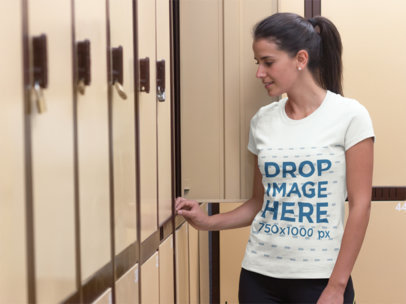 Woman at a Gym's Locker Room T-Shirt Mockup Template a7999