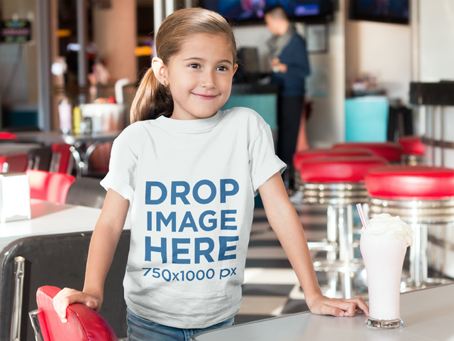 Little Girl at a Diner Having a Milkshake T-Shirt Mockup a8039