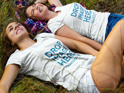 Happy Girls Lying on the Grass at a Park T-Shirt Mockup a7179
