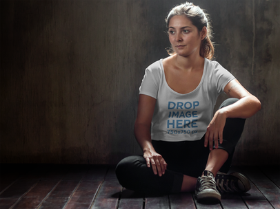 T-Shirt Mockup of a Girl Sitting Cross-Legged on the Floor a6458