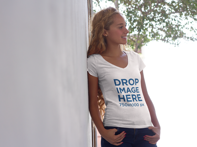 Beautiful Girl Leaning Against a Wall T-Shirt Mockup a7805