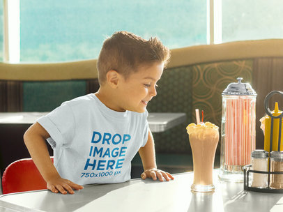 Young Boy Having a Milkshake T-Shirt Mockup a8036