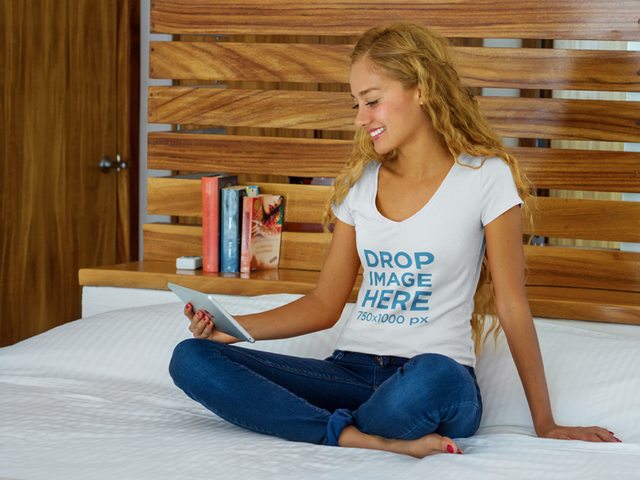 Smiling Young Woman Reading in Bed T-Shirt Mockup a7795