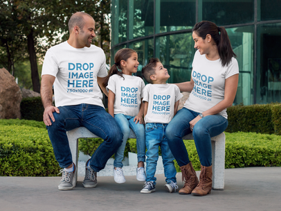 Family Sitting on a Bench Outdoors T-Shirt Mockup a8043