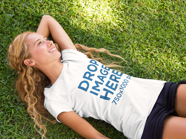 T-Shirt Mockup Featuring a Girl Lying on the Grass a7808