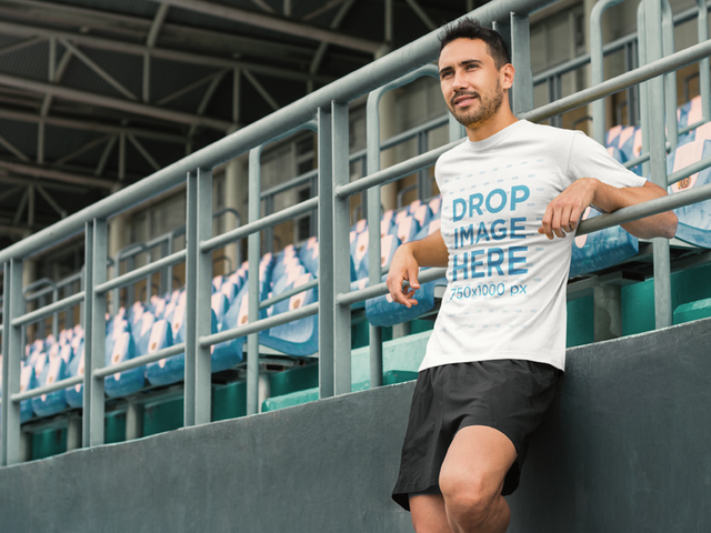 Athletic Man at a Sports Stadium T-Shirt Mockup a8032