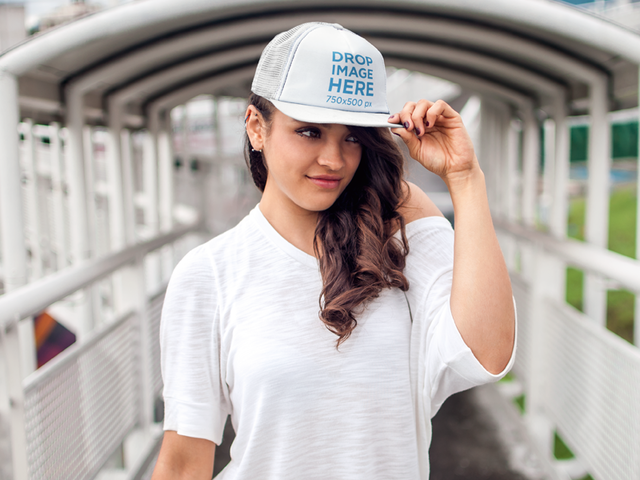 Young Woman Standing on a Pedestrian Bridge Hat Mockup a7653