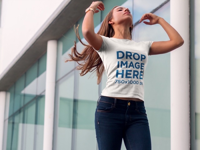 Girl Standing by a Modern Office Building T-Shirt Mockup a6561