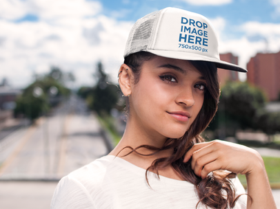 Young Woman Walking Through a Pedestrian Bridge Hat Mockup a7652