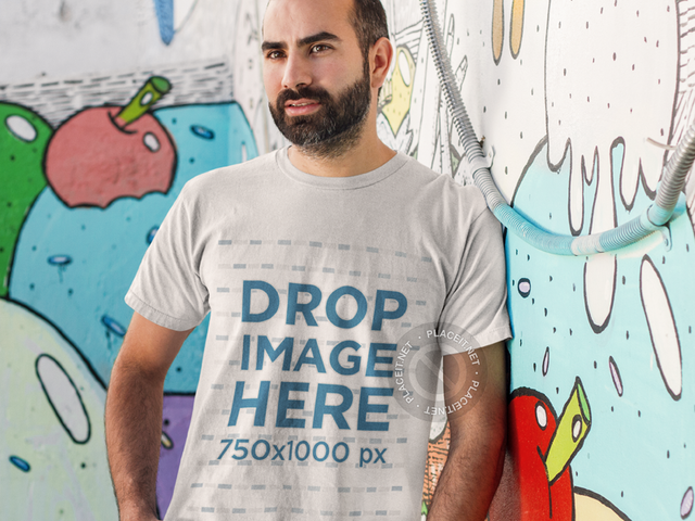 Man Standing in Front of a Graffiti Wall T-Shirt Mockup