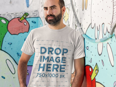 Man Standing in Front of a Graffiti Wall T-Shirt Mockup a8221