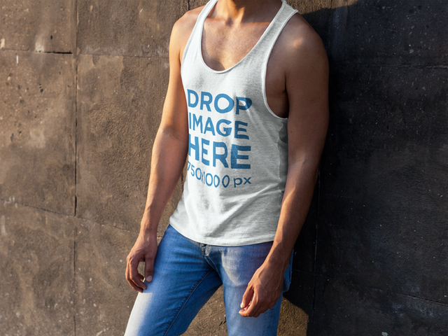 Tank Top Mockup of a Man Leaning Against a Concrete Wall a7846