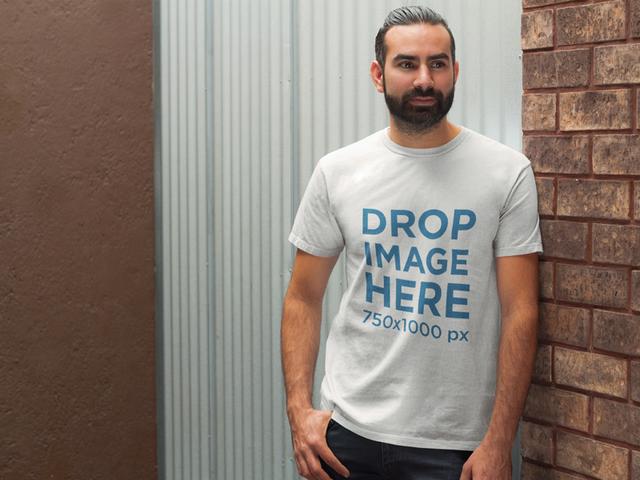 Bearded Man Standing Next to a Brick Wall T-Shirt Mockup