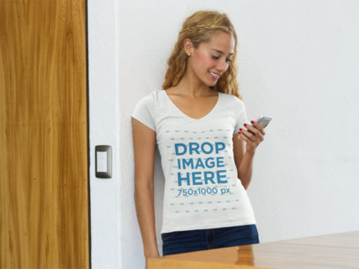 Young Woman at Home Using an iPhone T-Shirt Mockup a7794