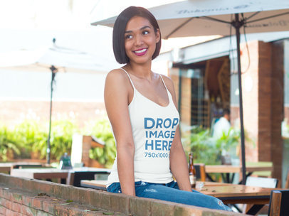 Woman Sitting at a Restaurant's Terrace Tank Top Mockup a8061