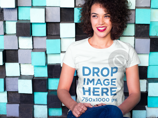 Woman Leaning on a Colorful Modern Wall T-Shirt Mockup