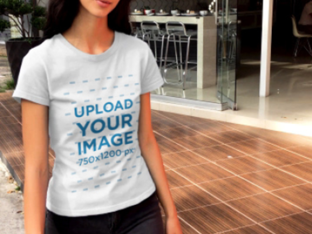 T-Shirt Video of a Slim Woman Walking Down a Street 23262
