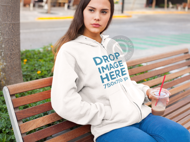 Hoodie Mockup of a Girl at a Park Having an Iced Coffee a7888