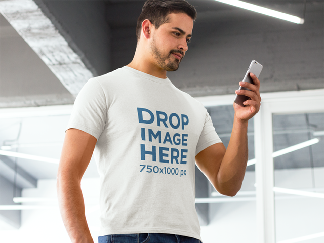 Man Using an iPhone at an Art Gallery T-Shirt Mockup a8440