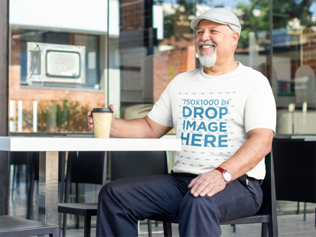 Elderly Man at a Cafe Enjoying a Coffee T-Shirt Mockup a8536