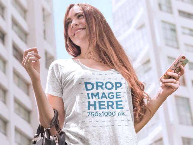 T-Shirt Mockup of a Smiling Young Woman on the Street a6065