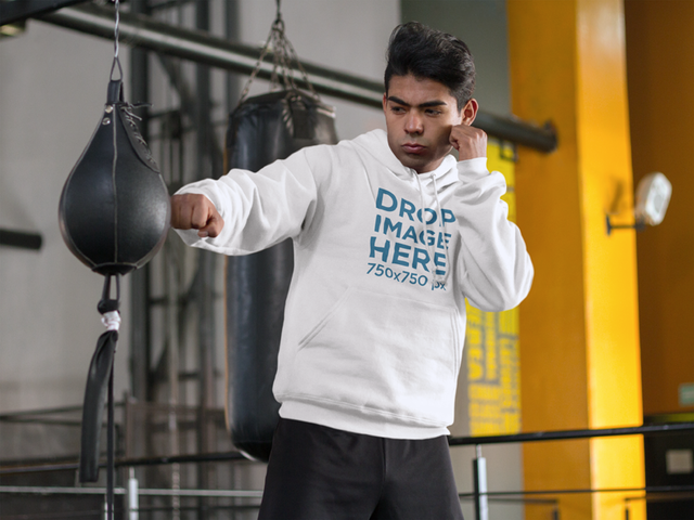 Guy at the Gym Training With Punching Bag Hoodie Mockup a8163
