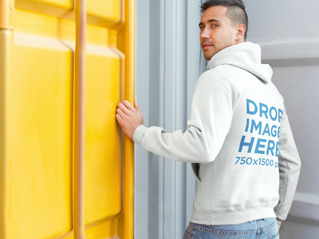 Young Man at a Construction Site Hoodie Mockup a8669