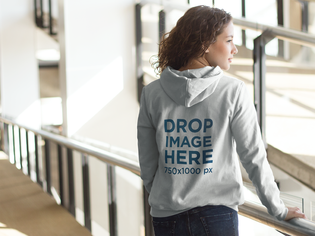 Hoodie Mockup of a Young Woman at a Library a8580