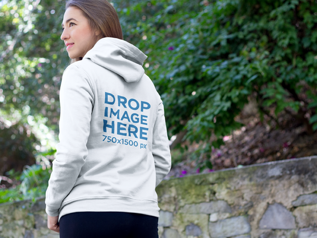 Hoodie Mockup Featuring a Young Woman at a Park a8517