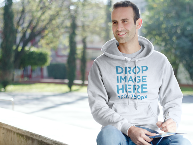 Male Student Sitting on a Bench at School Hoodie Mockup a8710