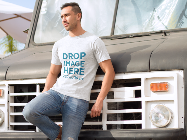 T-Shirt Mockup of a Young Man Leaning on an Old Truck a8680