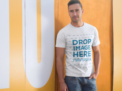 Man Standing Outside a Restaurant T-Shirt Mockup a8670
