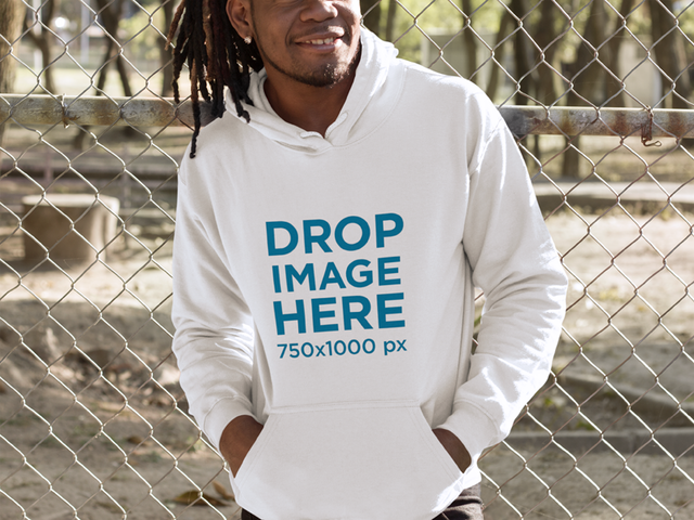 Smiling Black Man With Dreadlocks Leaning on a Fence Hoodie Mockup a8762