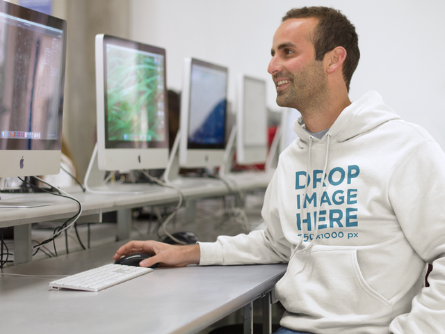 Smiling Student in Computer Lab Hoodie Mockup a8694