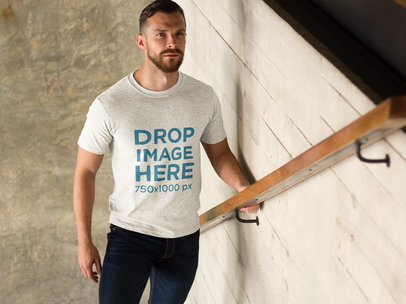 Man Walking Up a Set of Stairs T-Shirt Mockup a8578
