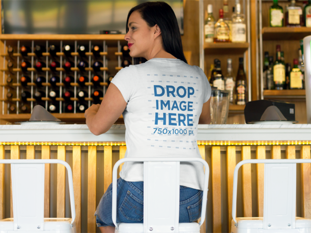 Back Shot of a Woman Sitting at a Bar T-Shirt Mockup a8503