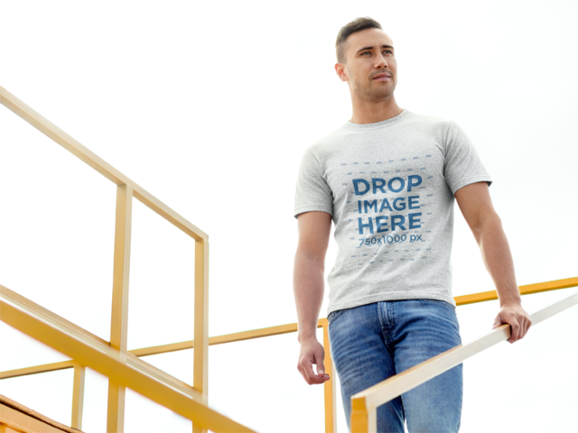 Man Standing on Sports Stadium Bleachers T-Shirt Mockup a8677
