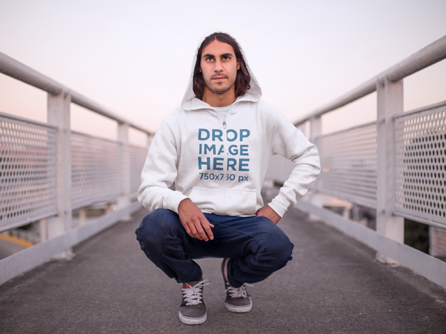 Man Crouching on Bridge at Dawn Hoodie Mockup a8968