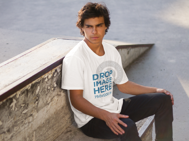 Young Man Sitting on a Concrete Bench T-Shirt Mockup