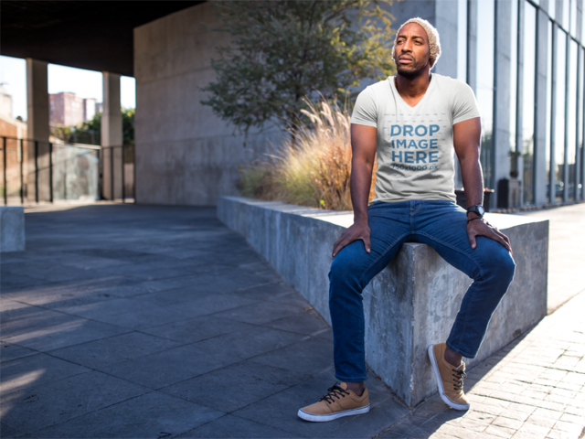 Black Man Sitting on a Concrete Planter T-Shirt Mockup a8978