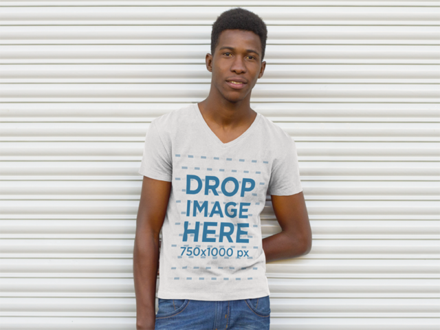 Man Standing Against a Rollup Steel Door T-Shirt Mockup a9281