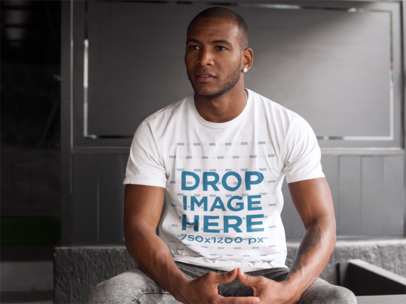 T-Shirt Mockup of a Man at a Bar Waiting for a Friend 9369f