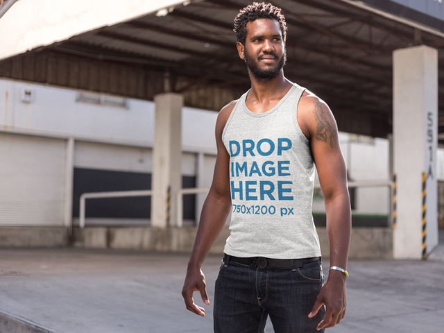 Tank Top Mockup of a Man Standing Outside a Warehouse a9530