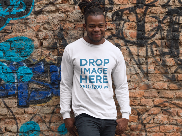 Long Sleeve T-Shirt Mockup of a Guy With Dreadlocks Leaning on a Graffiti Covered Wall 9291f