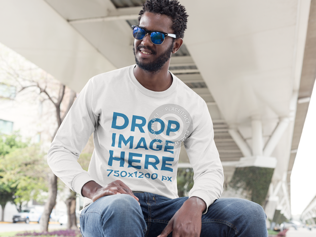 Long Sleeve T-Shirt Mockup of a Man Sitting on a Bench