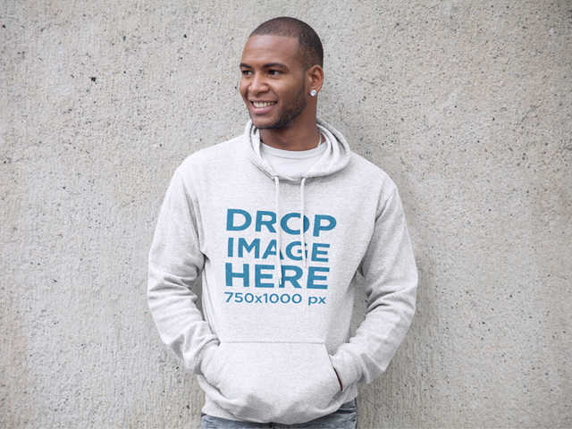 Hoodie Mockup of a Black Man Leaning Against a Wall a9316