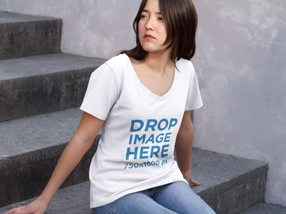 T-Shirt Mockup of an Asian Girl Sitting on a Stairway a9170