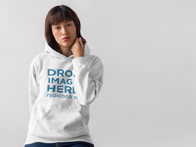 Hoodie Mockup of a Beautiful Woman in a Photo Studio a9917