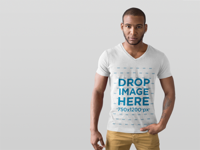 T-Shirt Mockup of a Handsome Man in a Photo Studio a9823